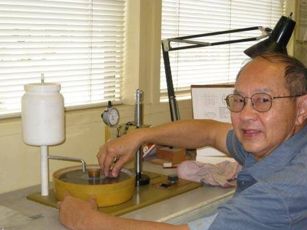 Tom Gan at one of the faceting machines.