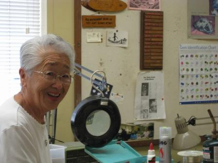 Haruko Asari doing her wire wrapping and showing some of our members how to wire wrap.
