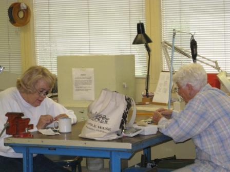 Ann Hurley and Phyllis Poper working on their project.