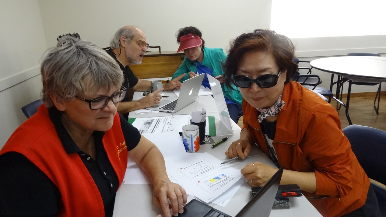 GAF Board Lillian Kennedy, and John Hlavac assisting Eunice Paik, and Gina Paik to sign up Ralph's Reward Program in CH 6